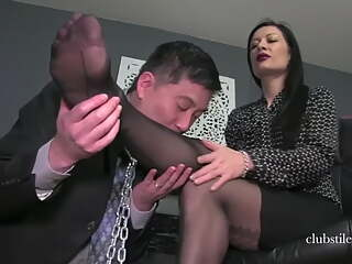 Man sniffs and licks his mistresses nylon feet
