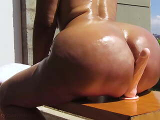 Massive oil ass ride dildo