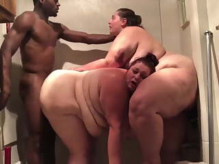 Two bbw enjoy bbc in the shower