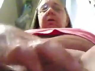 Dirty talking granny rubs pussy