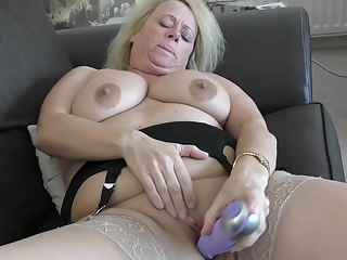 British granny with blonde hair, Ann is squeezing her big boobs and toying her soaking wet pussy