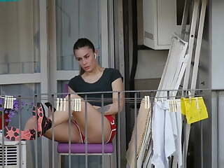 Candid girl relaxing on the balcony