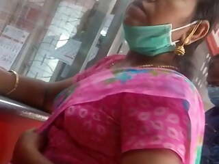Tamil young aunty showing her big boobs and navel in bank