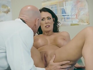 This beautiful mature wife is fucked on the bed in the doctor's office after being accompanied by her cuckold husband. - THEPORNCLINIC.COM