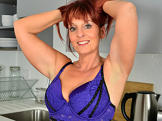 Sexy redhead Beau Diamonds is looking fine in jeans. The bigtit milf loves playing with her giant knockers as she takes her bra off, but as soon as she gets down...
