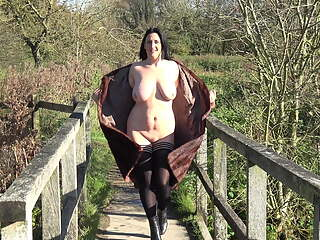 Jenny flashing by the English river in winter