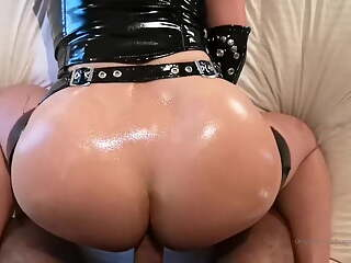 Redhead with big tits in latex gives blowjob & gets fucked