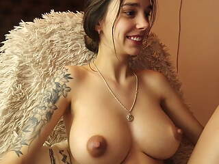 Cute brunette with round boobs rubs pussy on cam