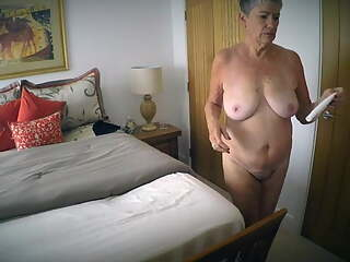 Gilf posing on her bed gets the cameraman excited