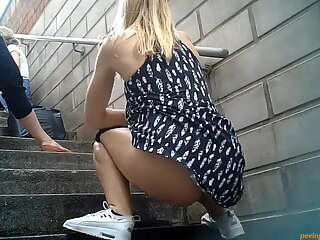 Girls pee on steps