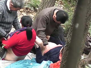 2 Asian Prostitutes With 2 Clients Outdoors