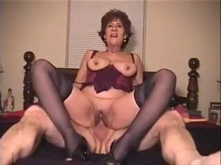 Older mom in lingerie rides dick