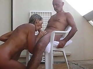 Mature couple fucks on the terrace