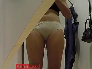 Malaysian girl checking out her ass in changing room