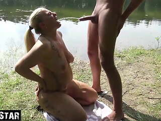 Horny Milf drinks piss outdoors