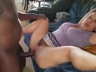 MILF takes big black cock in both her holes