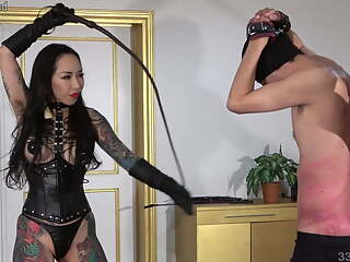 Japanese dominatrix Youko whips and bites the masochist man
