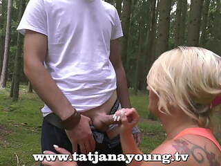 busty german milf blows outdoor