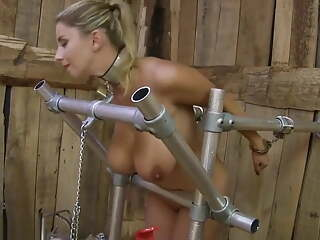 Busty naked blonde cuffed and milked on farm