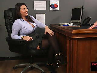 Busty office voyeur teasing subject's dick with her feet