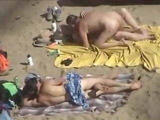 2 couples at the beach